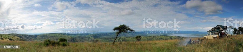 Man overlooking a savannah in Rwanda royalty-free stock photo
