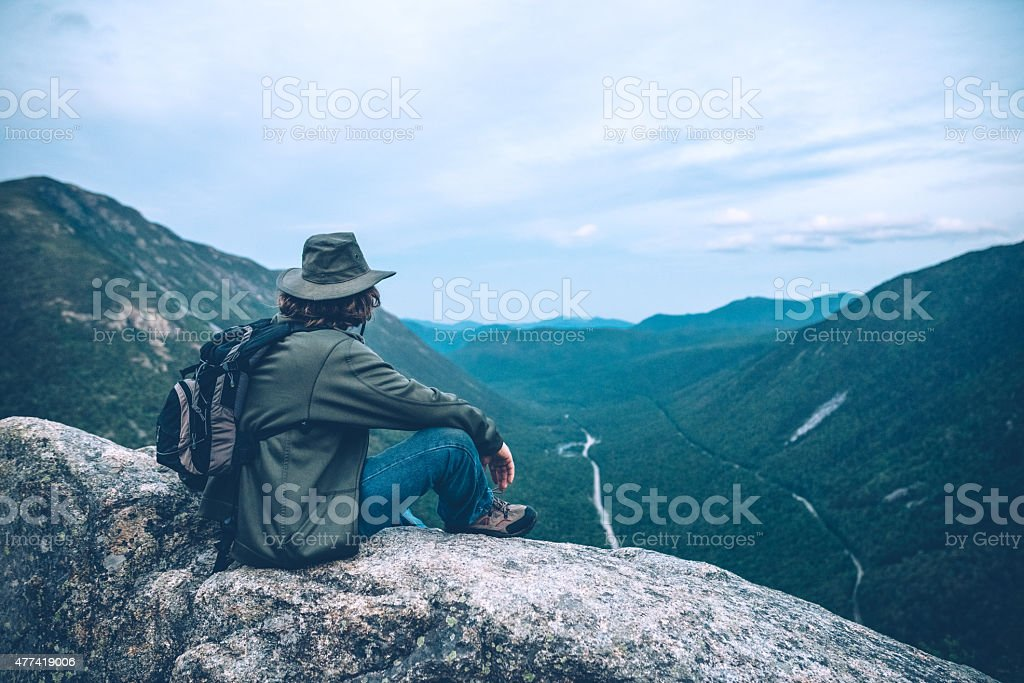 Man overlooking Crawford Notch in New Hampshire stock photo