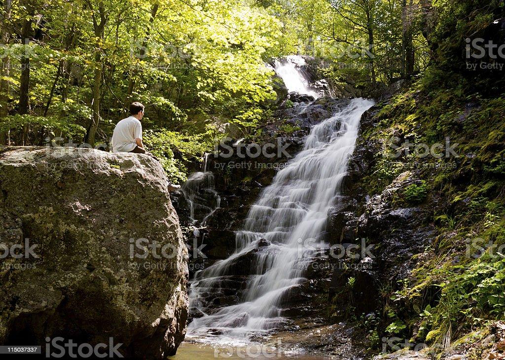 Man overlooks Overall Run waterfall stock photo