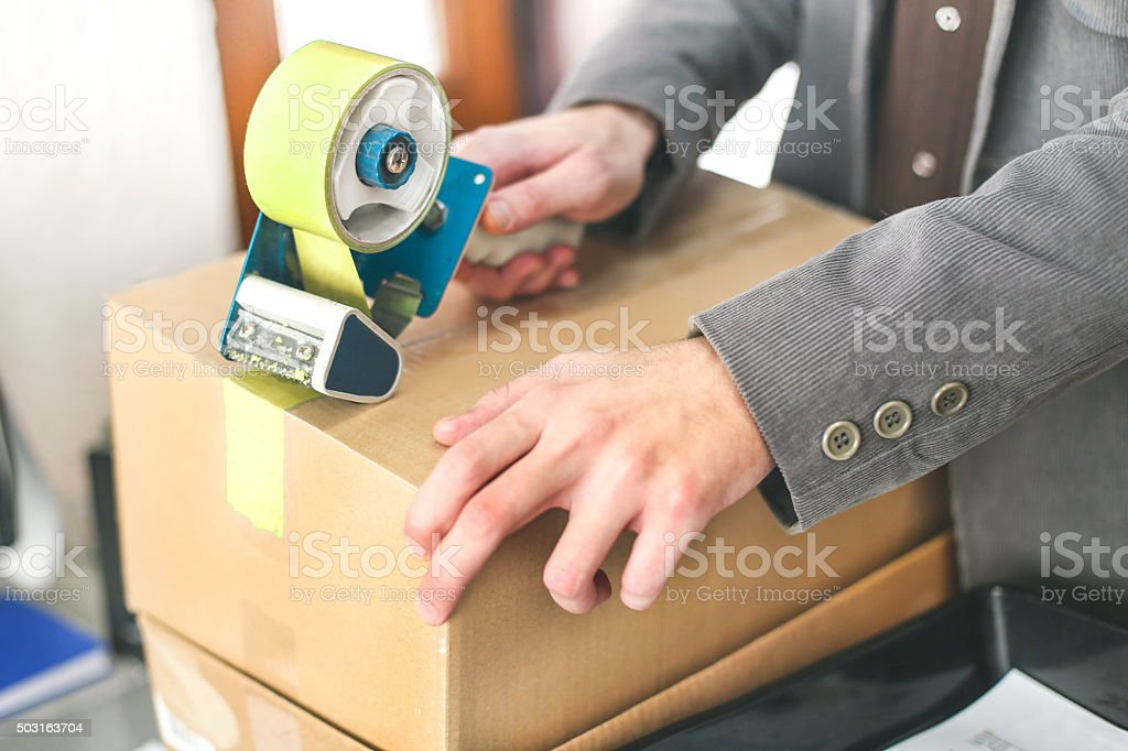 Man packing boxes stock photo