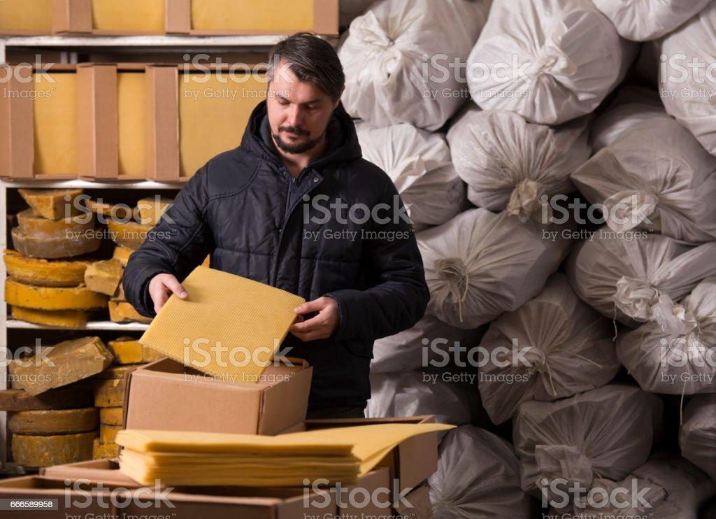 Man packing honeycomb sheets. stock photo