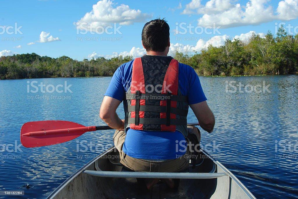 Man Paddling a Canoe royalty-free stock photo