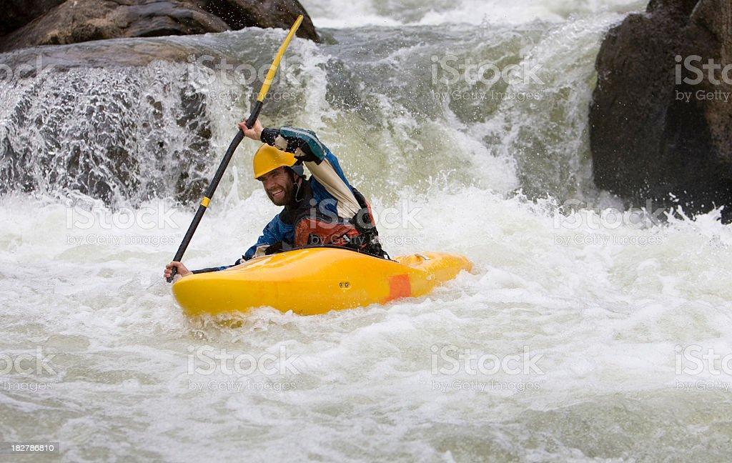 Man Paddling a White Water Kayak on an Idaho River. royalty-free stock photo