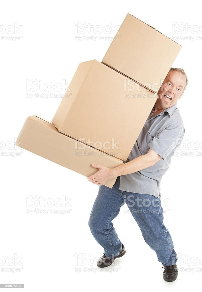 Man Painfully Carrying Boxes stock photo