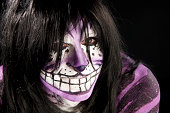 Man painted as Cheshire Cat, closeup.