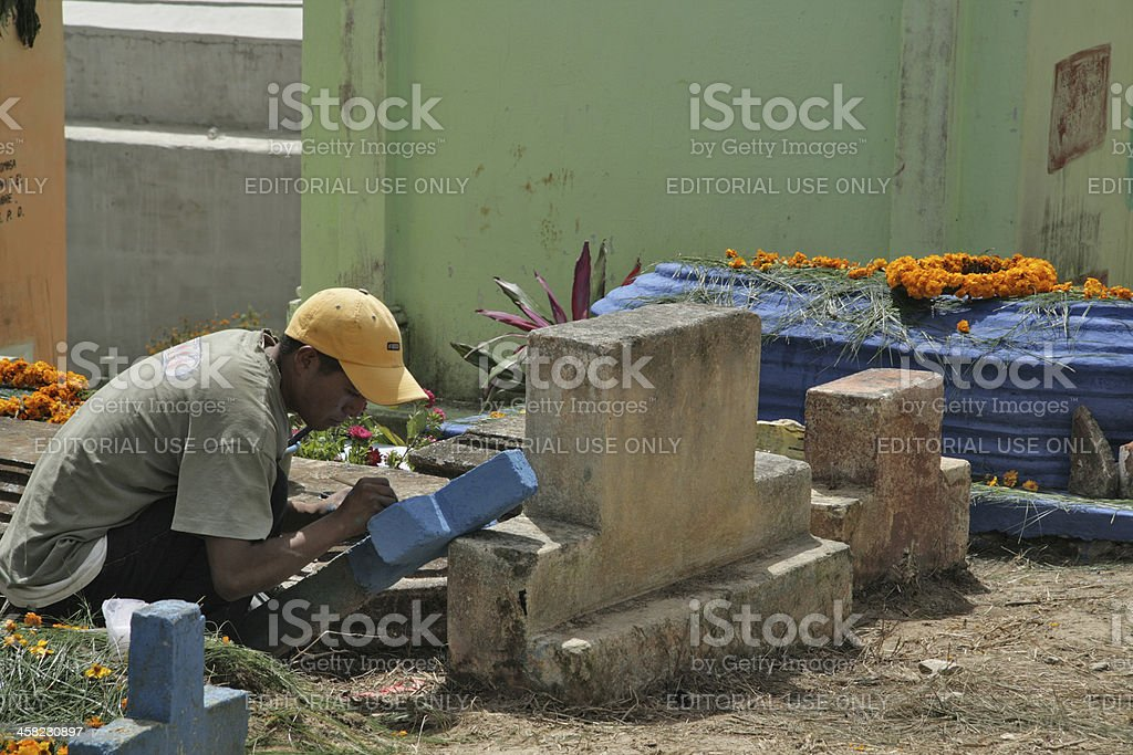 Man painting a gravestone in Solola, Guatemala royalty-free stock photo