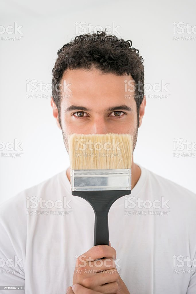 Man painting a house stock photo