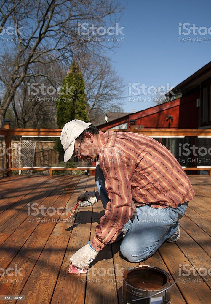 Man Painting Deck stock photo