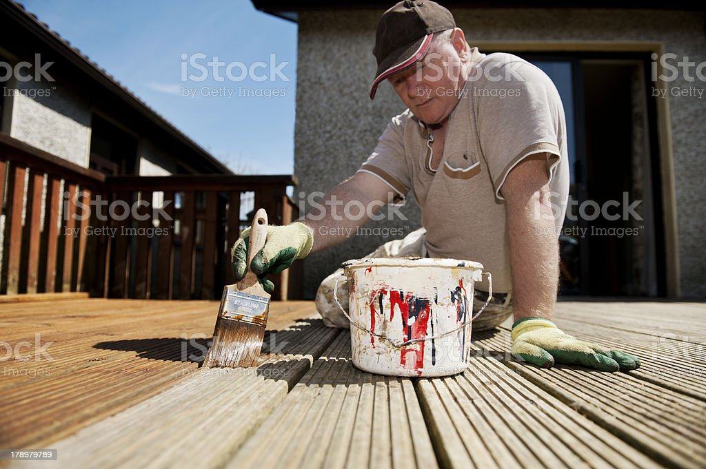 Man painting decking stock photo