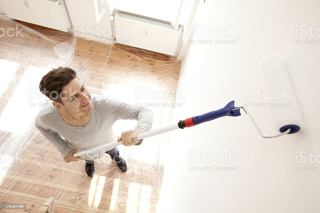 Man painting his appartment stock photo