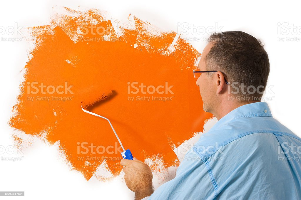 man painting his home royalty-free stock photo
