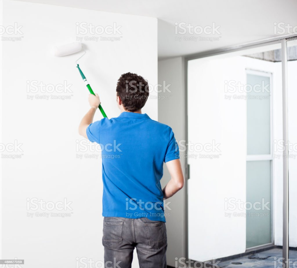 Man painting house royalty-free stock photo