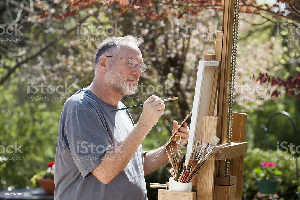 Man Painting Outdoors royalty-free stock photo