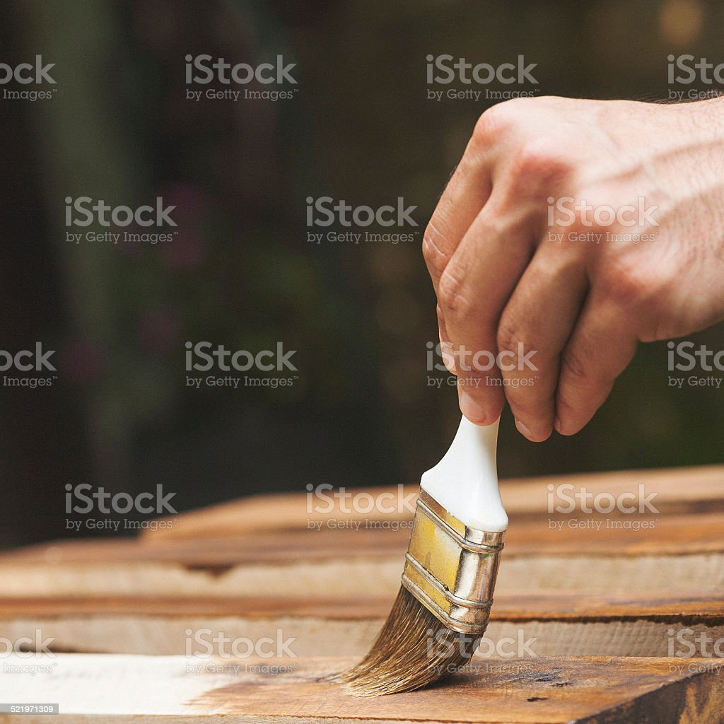 Man painting the fence stock photo