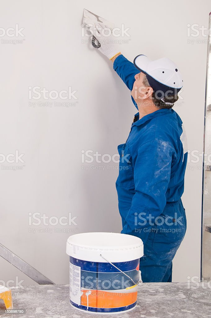 Man painting the wall royalty-free stock photo