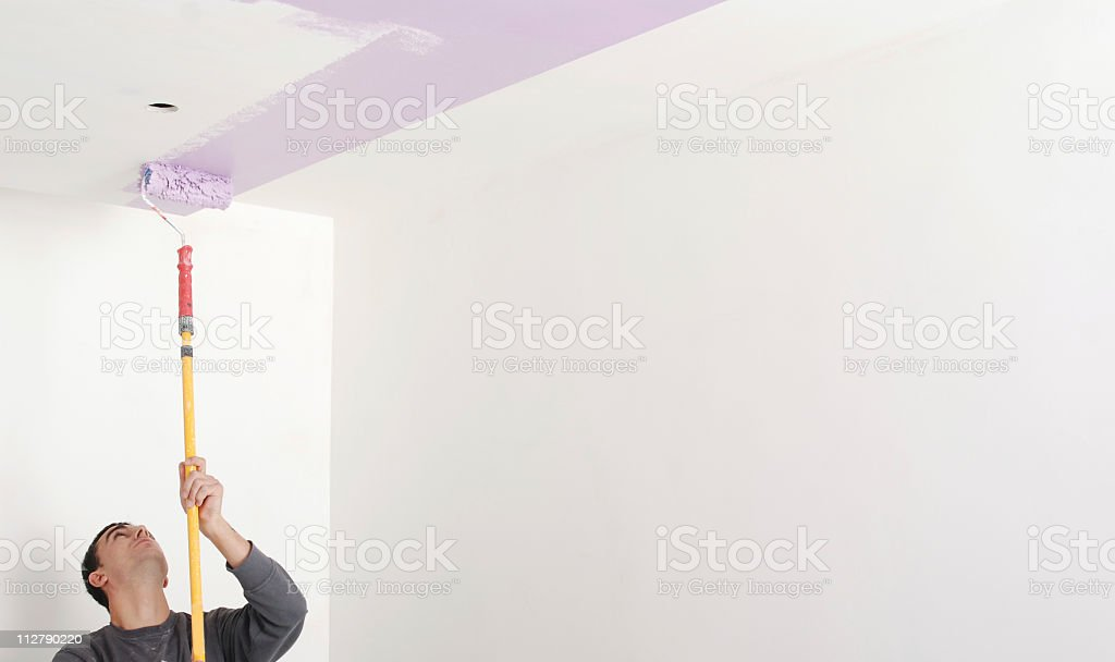 Man painting wall stock photo