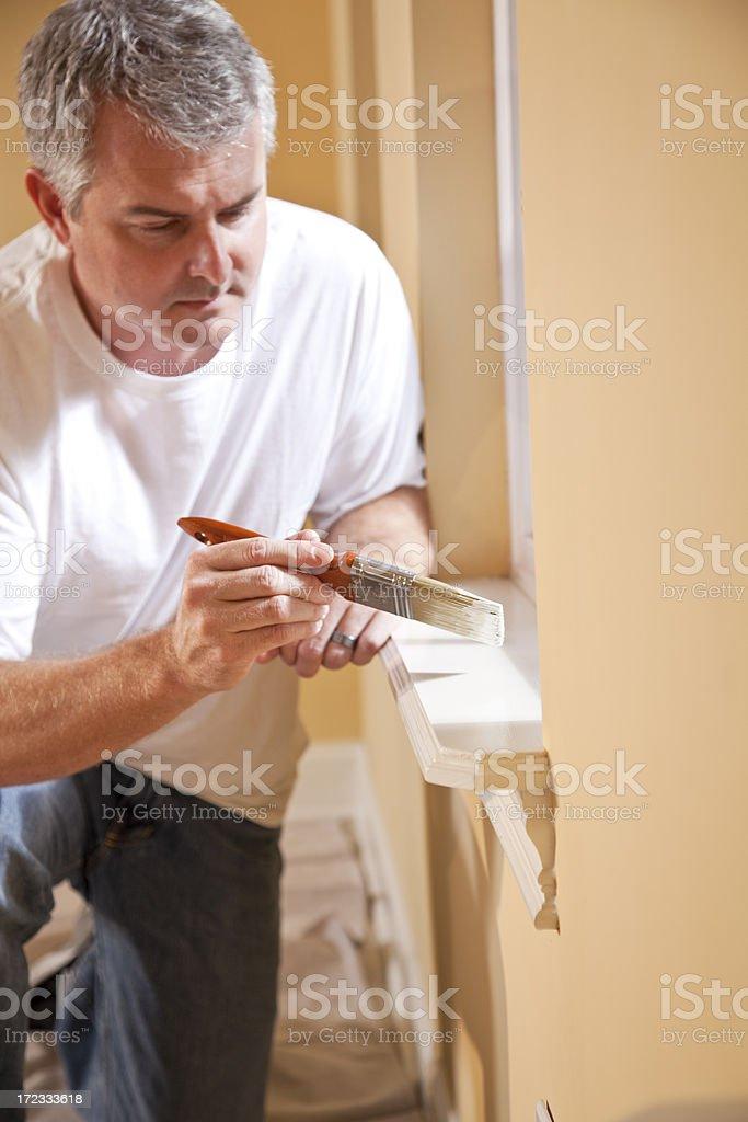 Man painting window sill royalty-free stock photo