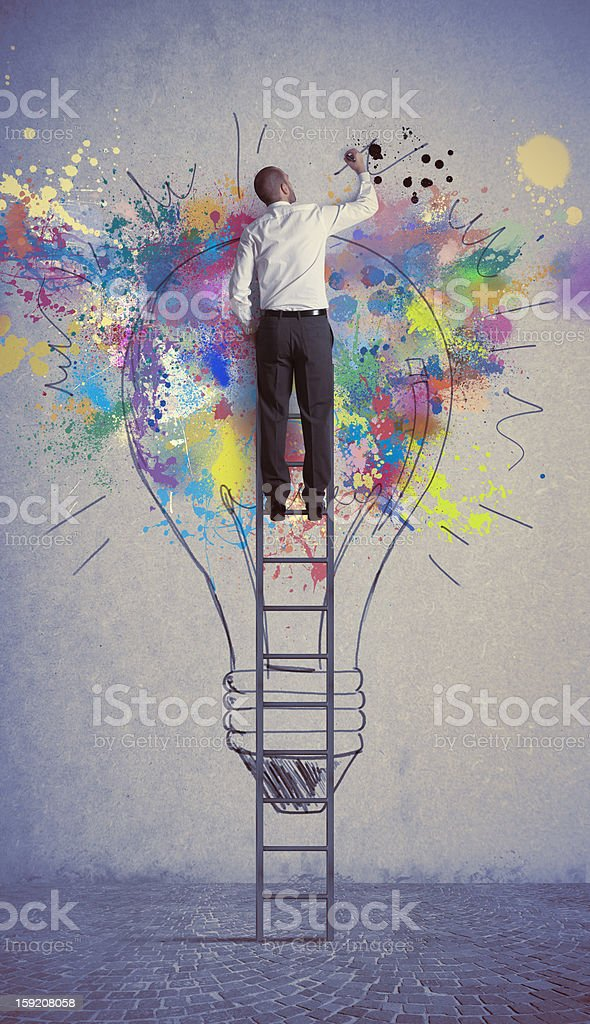 Man paints a creative business idea light royalty-free stock photo