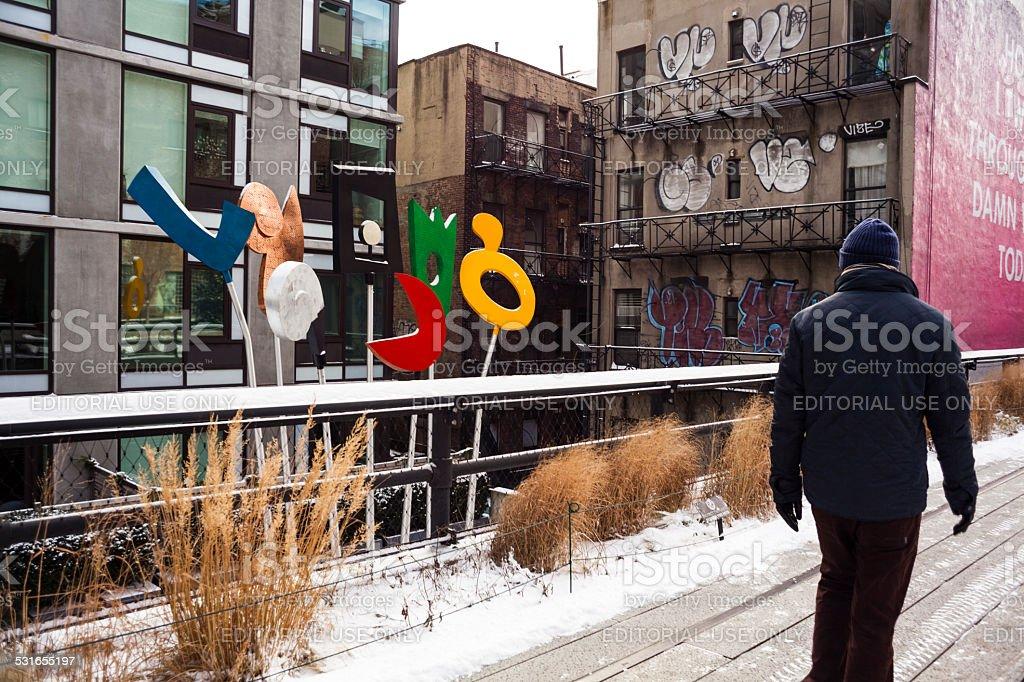 Man passes Urban Rattle sculpture. Charles Hewitt. High Line. stock photo