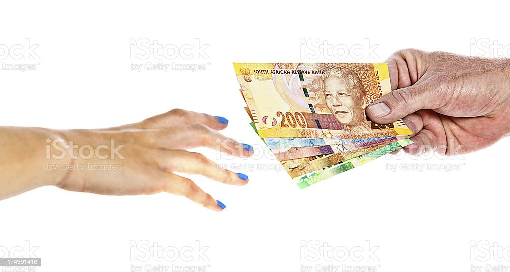 Man passes varied new South African Mandela banknotes to woman stock photo