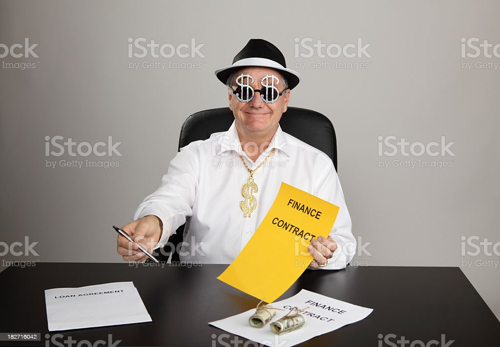 A man passing a pen and signing contract to someone stock photo