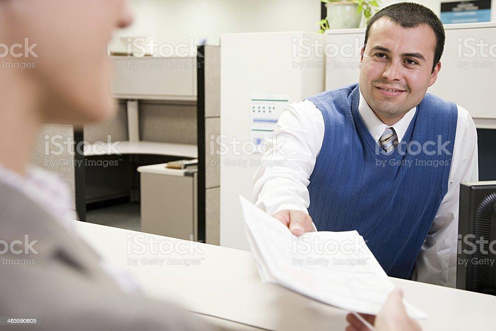 Man passing paper stock photo