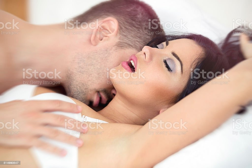 Man passionately engaged in sex stock photo