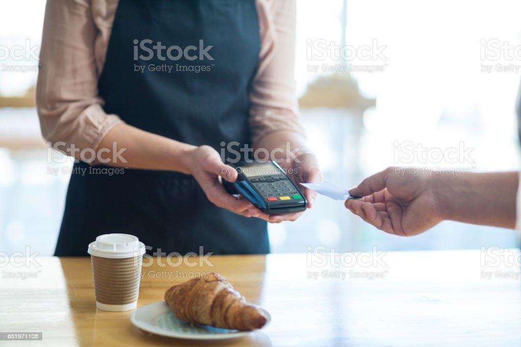 Man paying bill through payment terminal stock photo