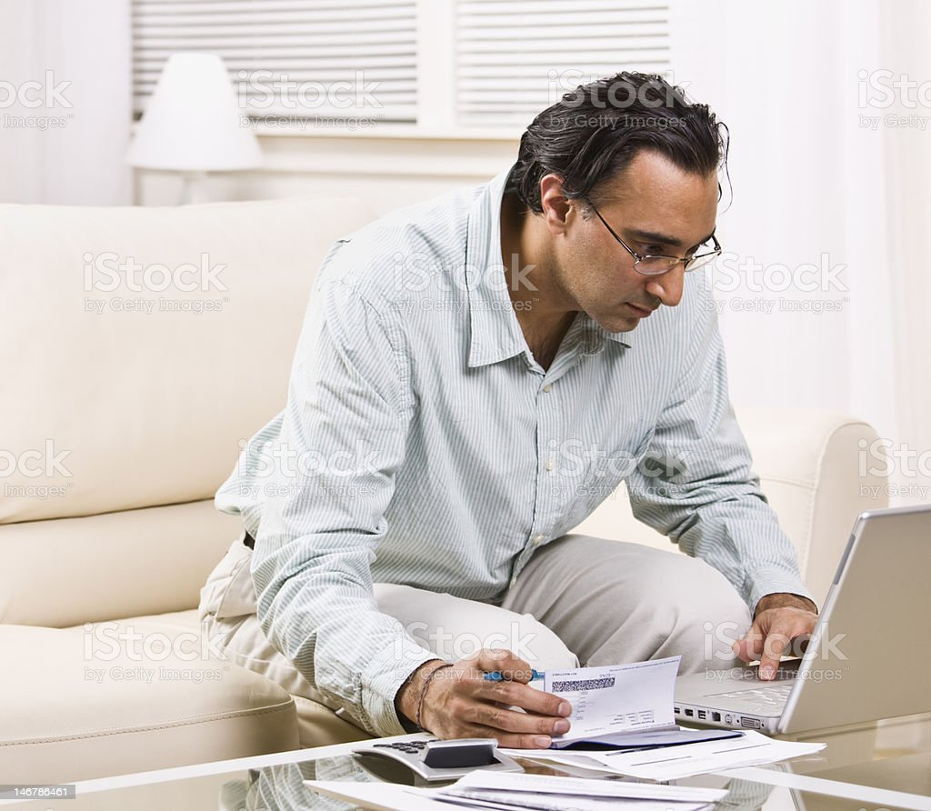 Man Paying Bills With Laptop stock photo