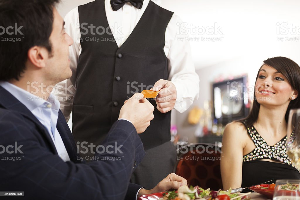 Man paying dinner royalty-free stock photo
