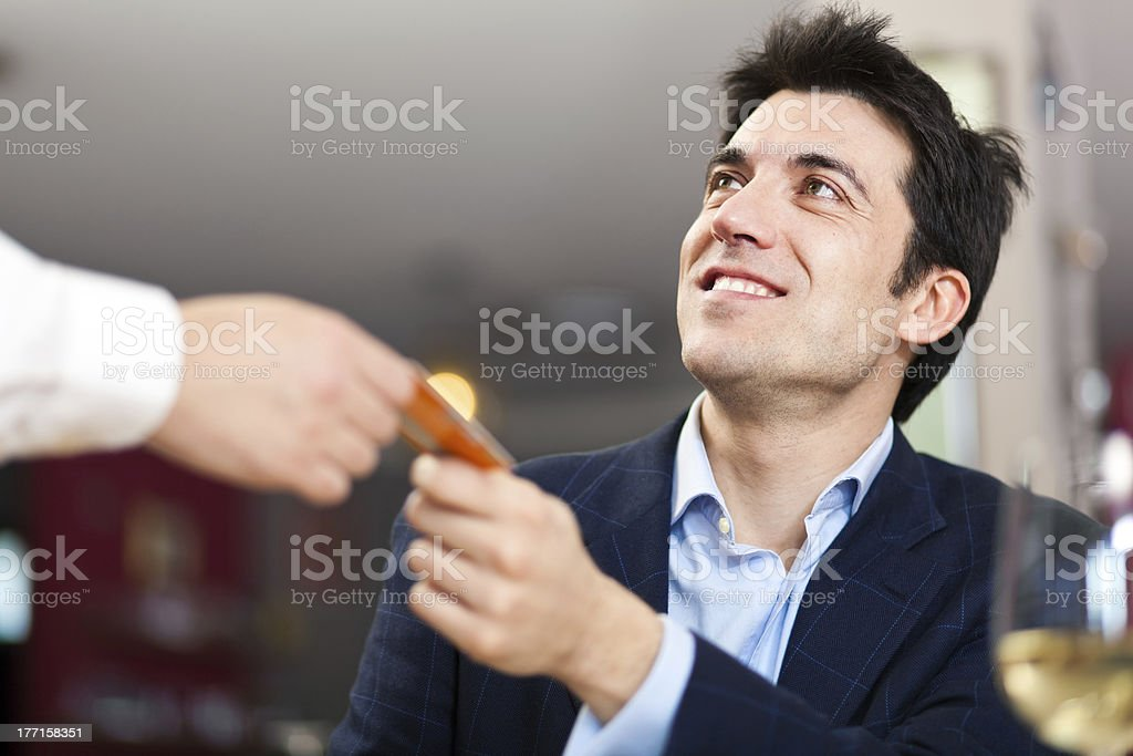 Man paying restaurant bill royalty-free stock photo