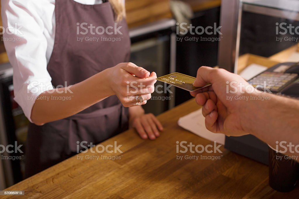 Man paying with credit card in the shop stock photo
