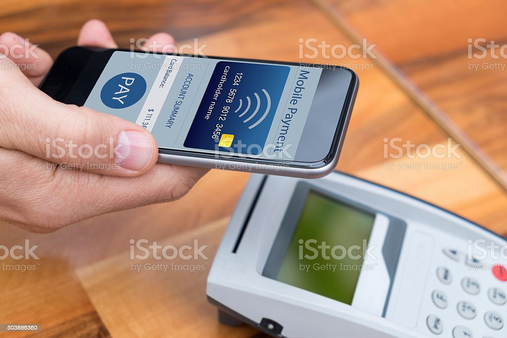 man paying with a smart phone using NFC or contactless payment...