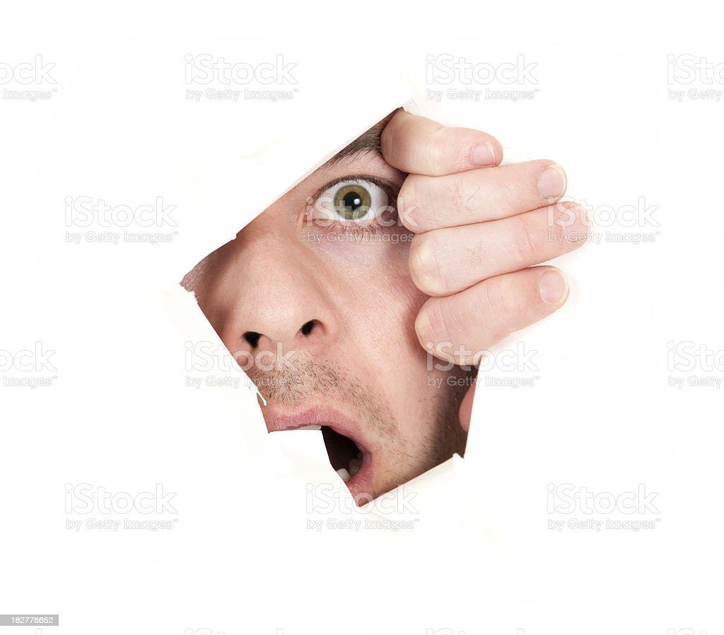 Man peeks through wall isolated on white royalty-free stock photo