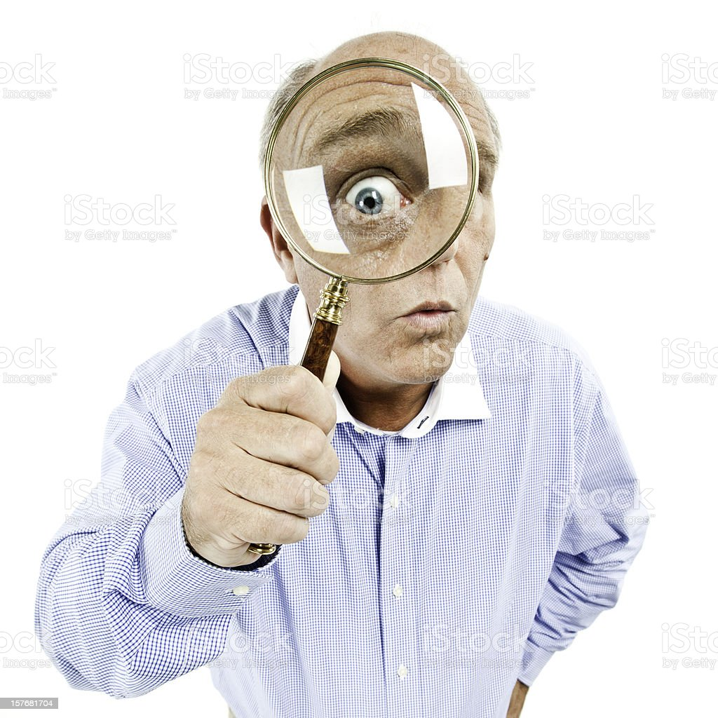 Man Peering through Magnifying Glass - Isolated royalty-free stock photo