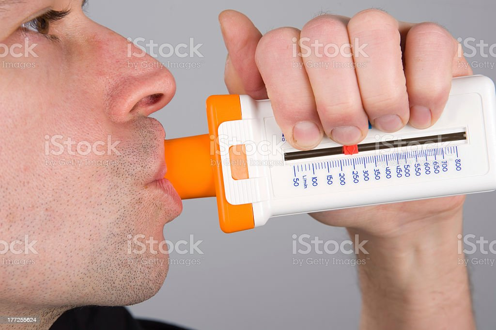 A man performing a lung function test stock photo