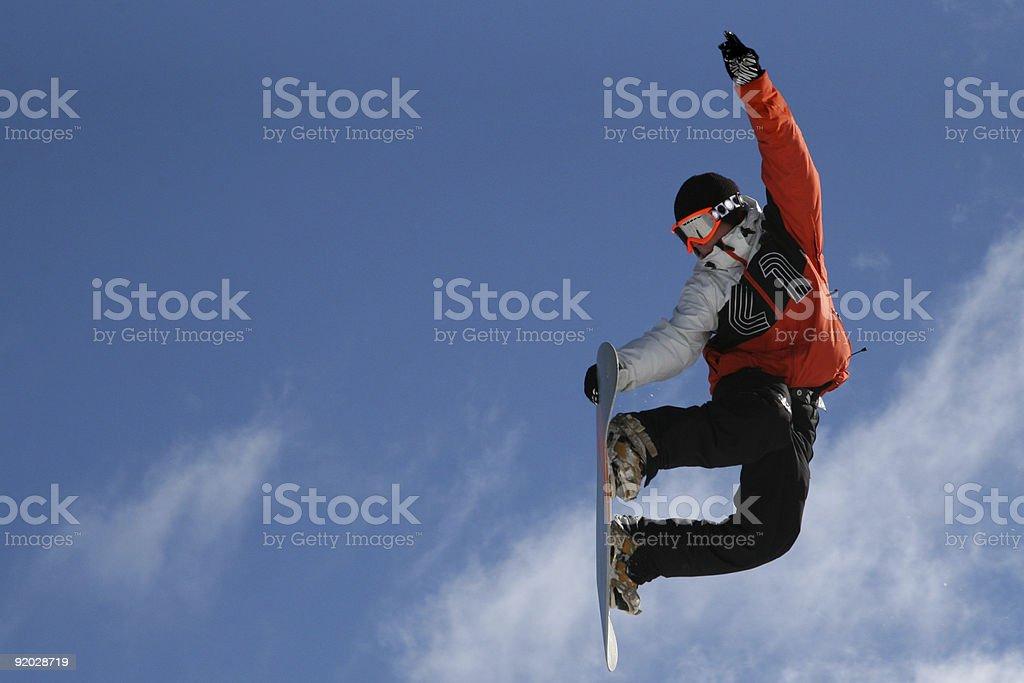 Man performing a snowboard jump royalty-free stock photo