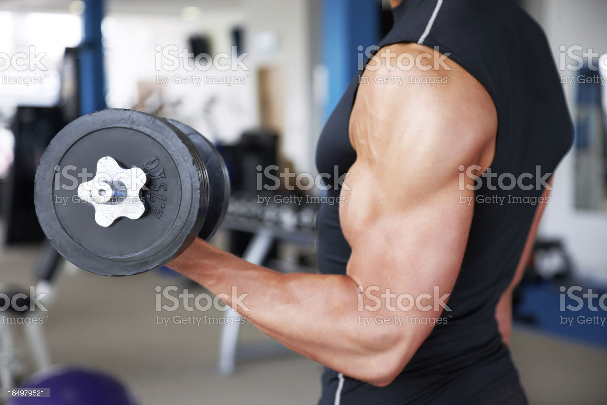 Man Performing Arm Curls royalty-free stock photo