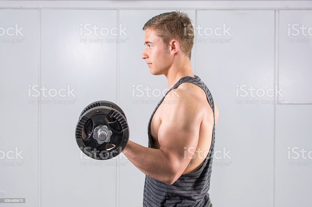Man performing biceps workout stock photo