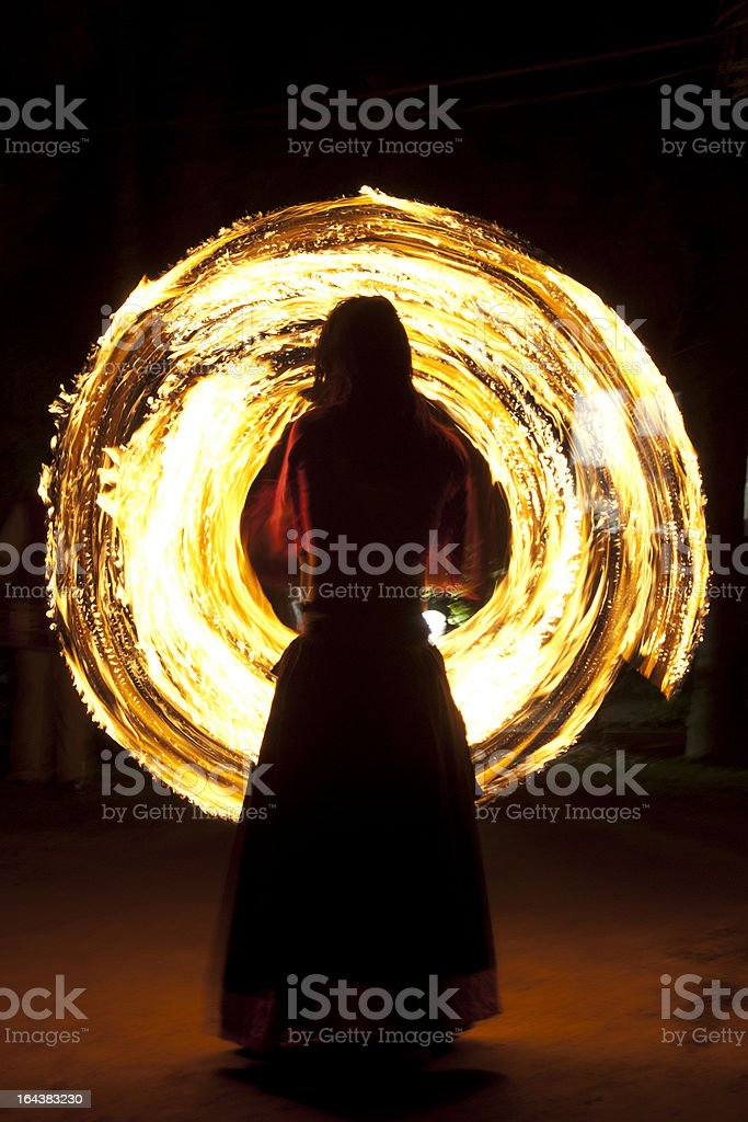 Man performing fire dance stock photo