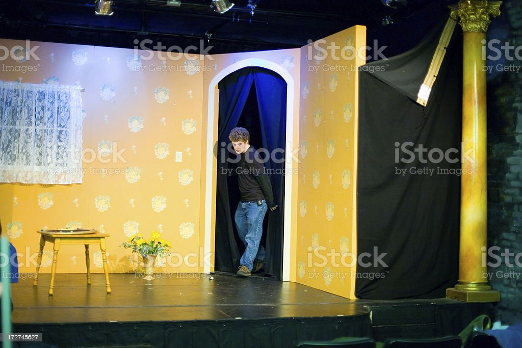Man performing in theatrical production with yellow set royalty-free stock photo