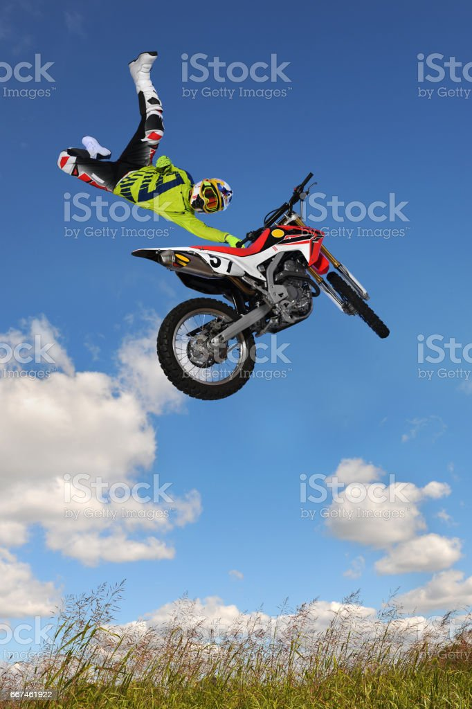 Man Performing Motorcycle Stunt stock photo