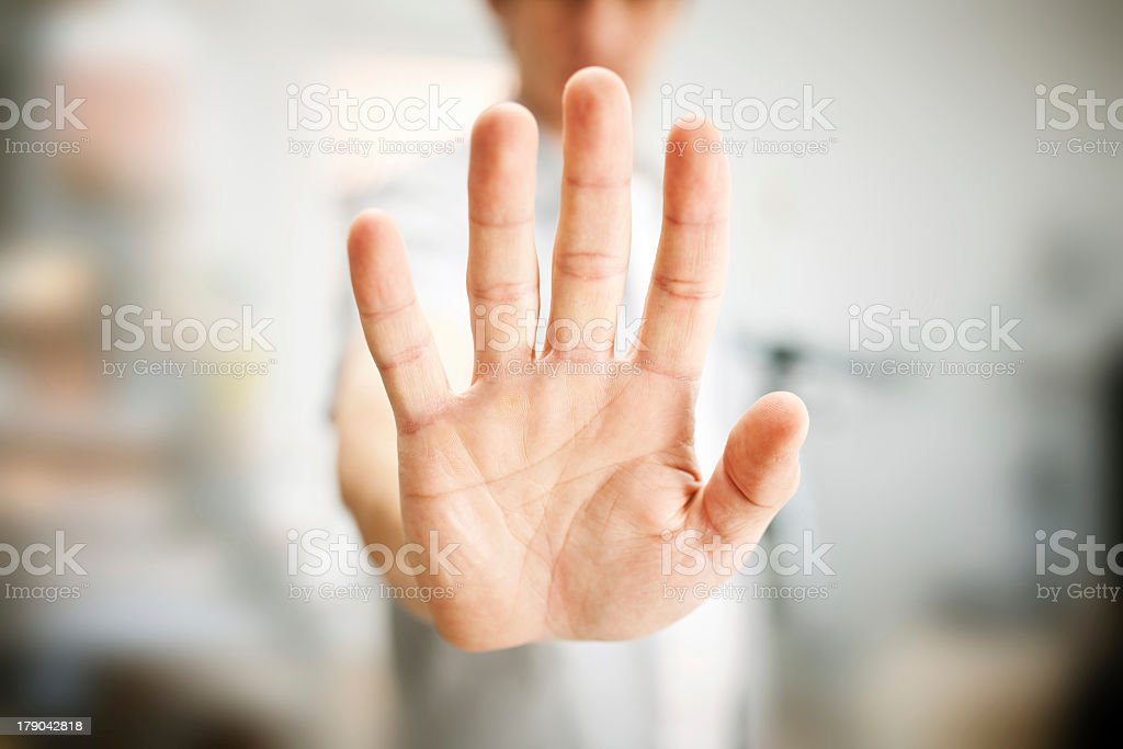 Man performing stop gesture with hand stock photo