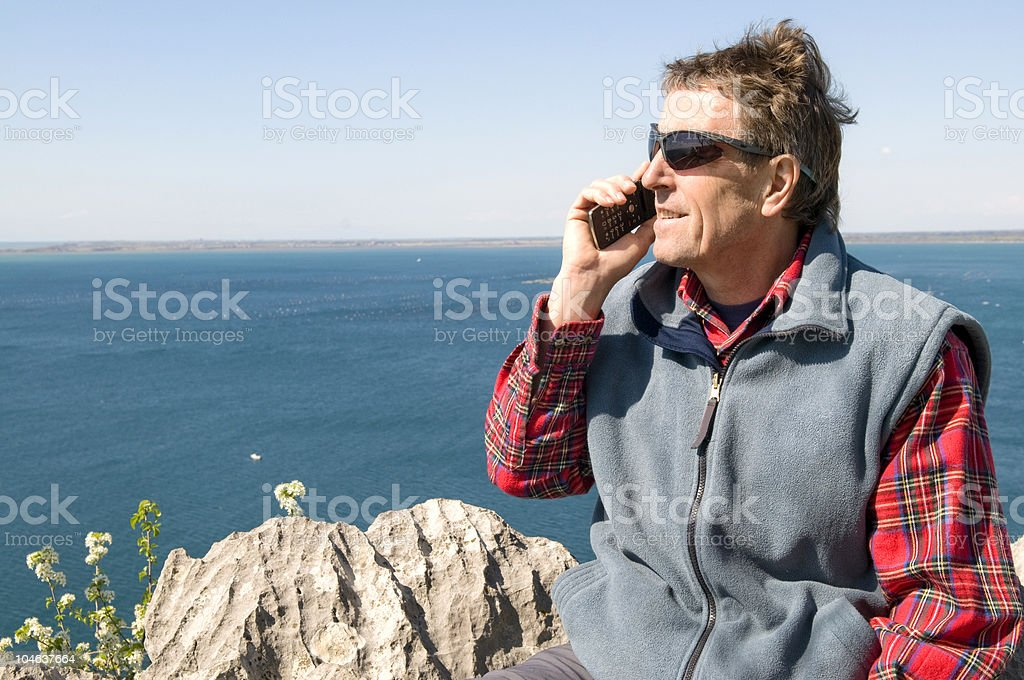 Man Phonecalling at Azure Sea royalty-free stock photo