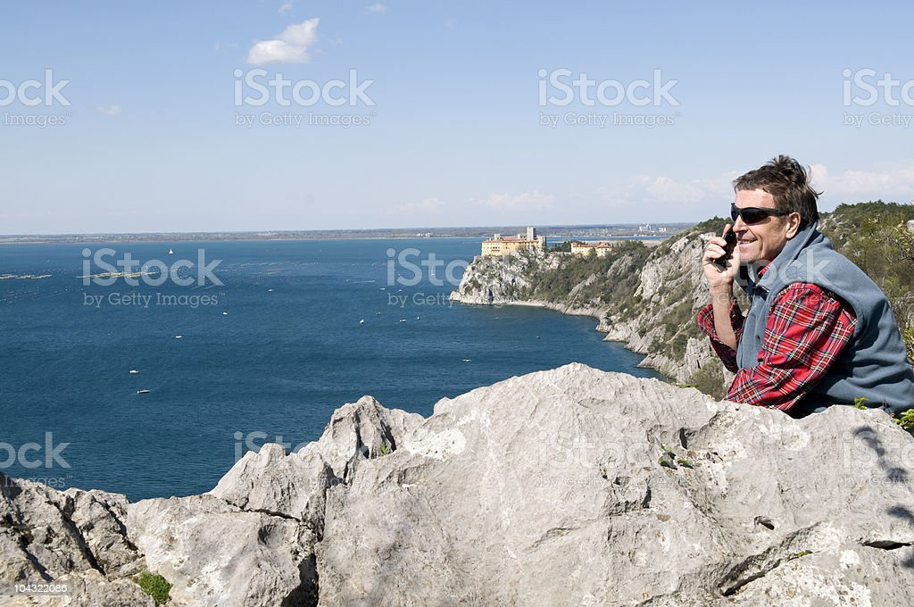 Man Phoning Duino Castle Adriatic Sea royalty-free stock photo