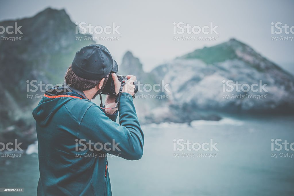 Man Photographer at Famous Pacific Coast Highway, Big Sur stock photo