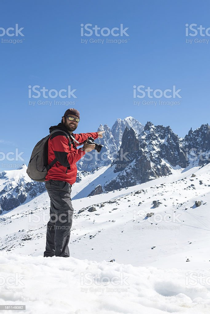 Man Photographer Taking Picture with DSLR Camera of Mountains royalty-free stock photo