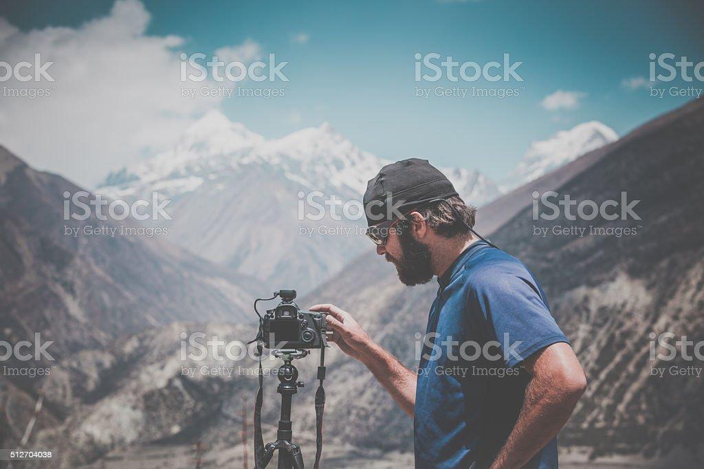 Man Photographer Using Camera Around Annapurna Trek, Nepal stock photo