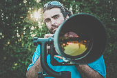 Man Photographer with Super Long Telephoto Lens
