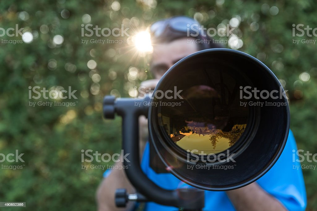 Man Photographer with Super Long Telephoto Lens stock photo